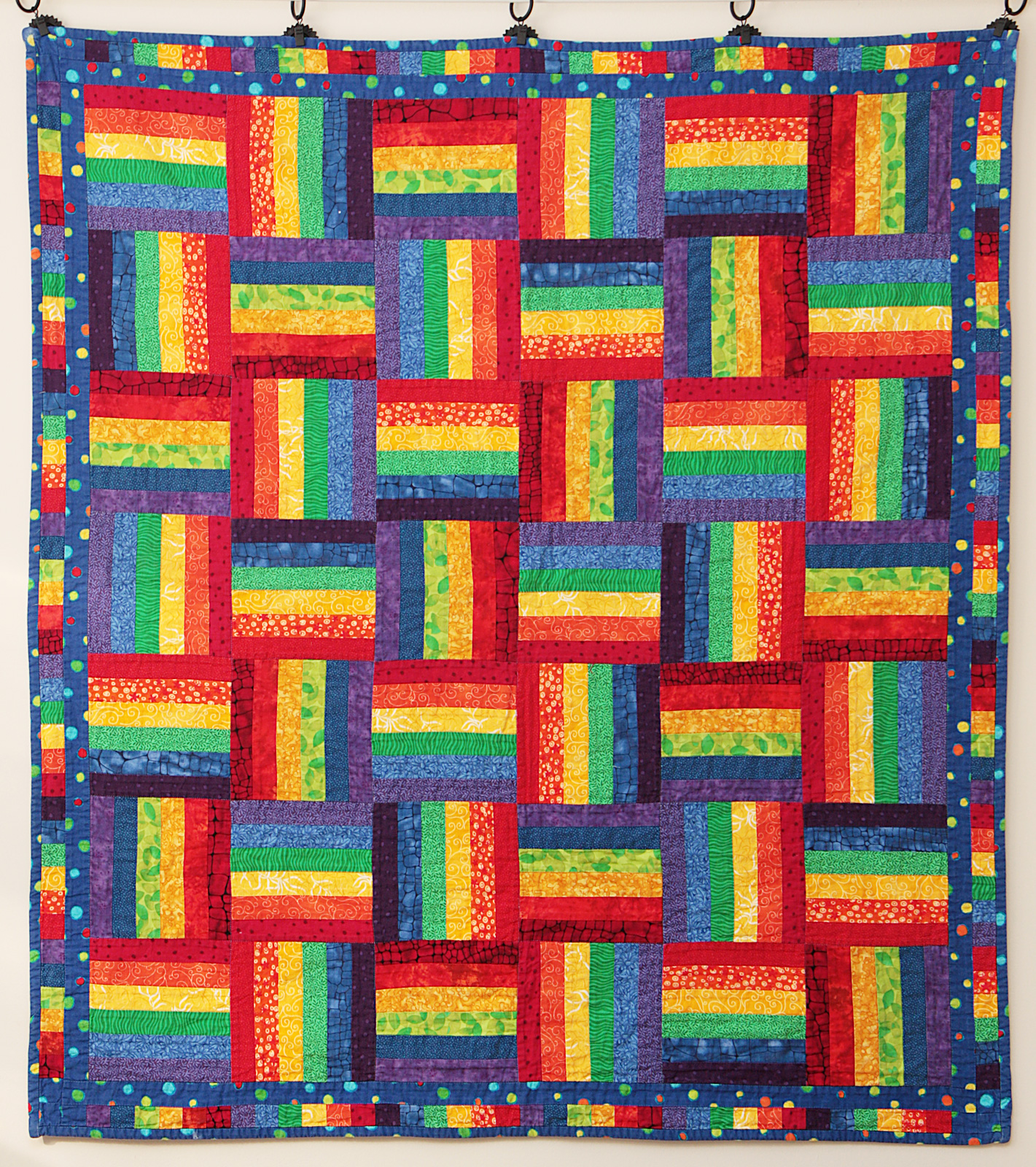 Rainbow rail fence quilt