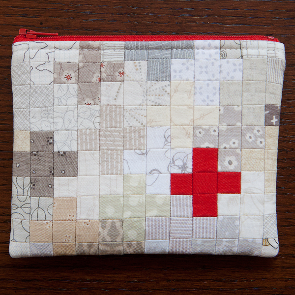 52 zippers #6: mini plus quilt using Quilter's grid interfacing