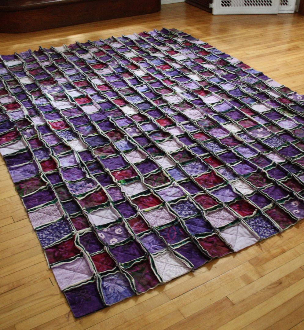 Purple raggy quilt
